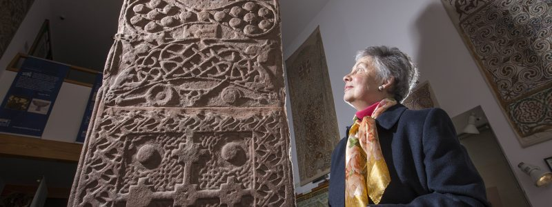Visitor looking at an ancient sculpture at Groam House Museum in Rosemarkie