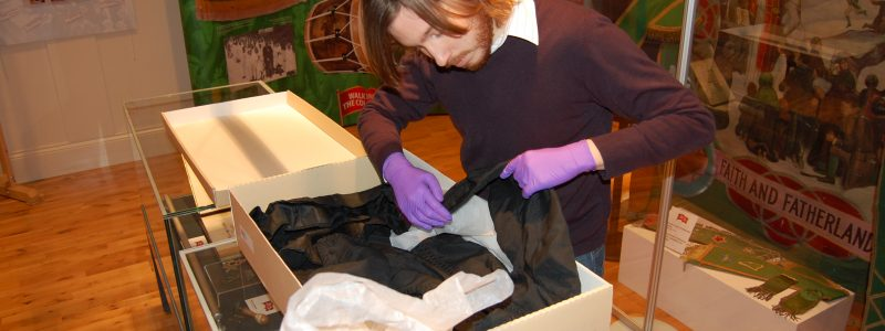 A museum worker checks for moths at Ballymoney Museum